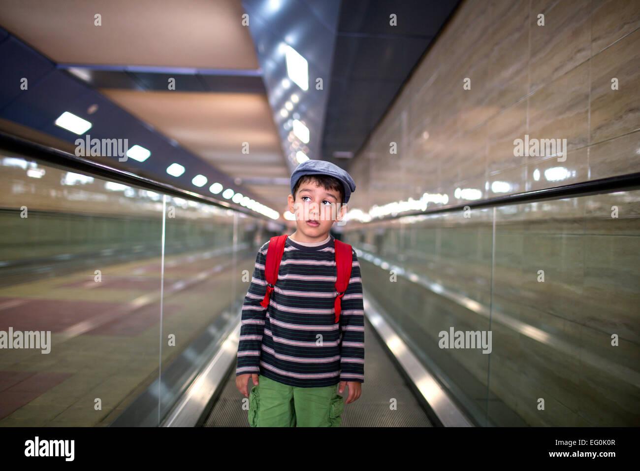 Bulgaria, Sofia, Boy (4-5) standing on escalator - Stock Image