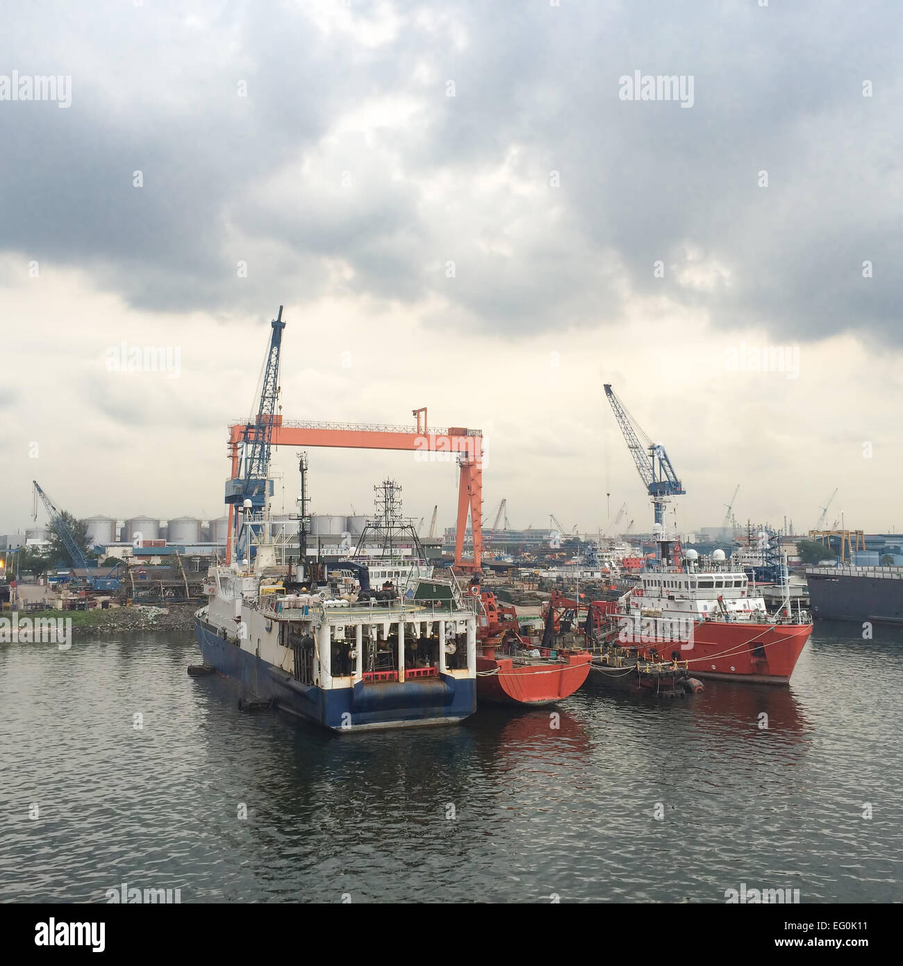 Industrial ships moored at pier of commercial dock - Stock Image