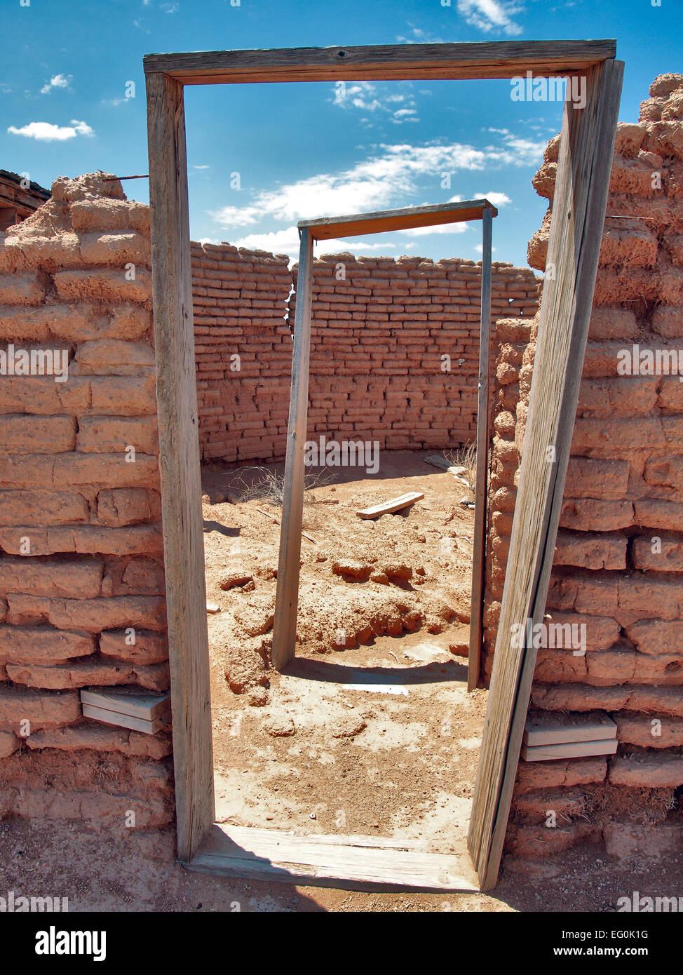 USA, Arizona, Yuma County, Aztec, Doorway frames of abandoned brick building - Stock Image