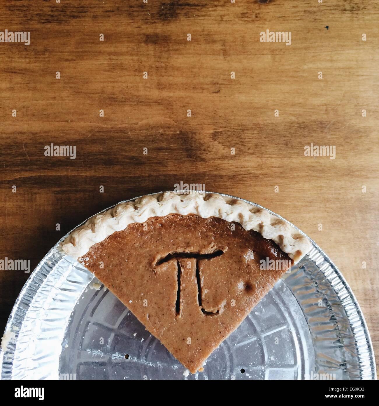 Pumpkin pie with Pi symbol - Stock Image