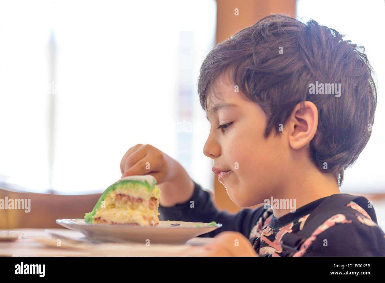 Bulgaria, Sofia, Young boy (4-5) eating cake Stock Photo
