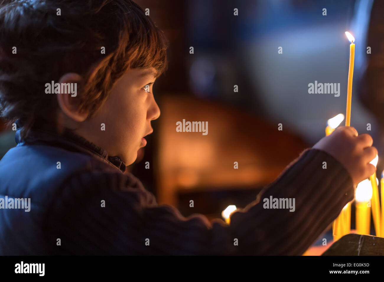 Bulgaria, Sofia, Young boy (4-5) holding candle - Stock Image