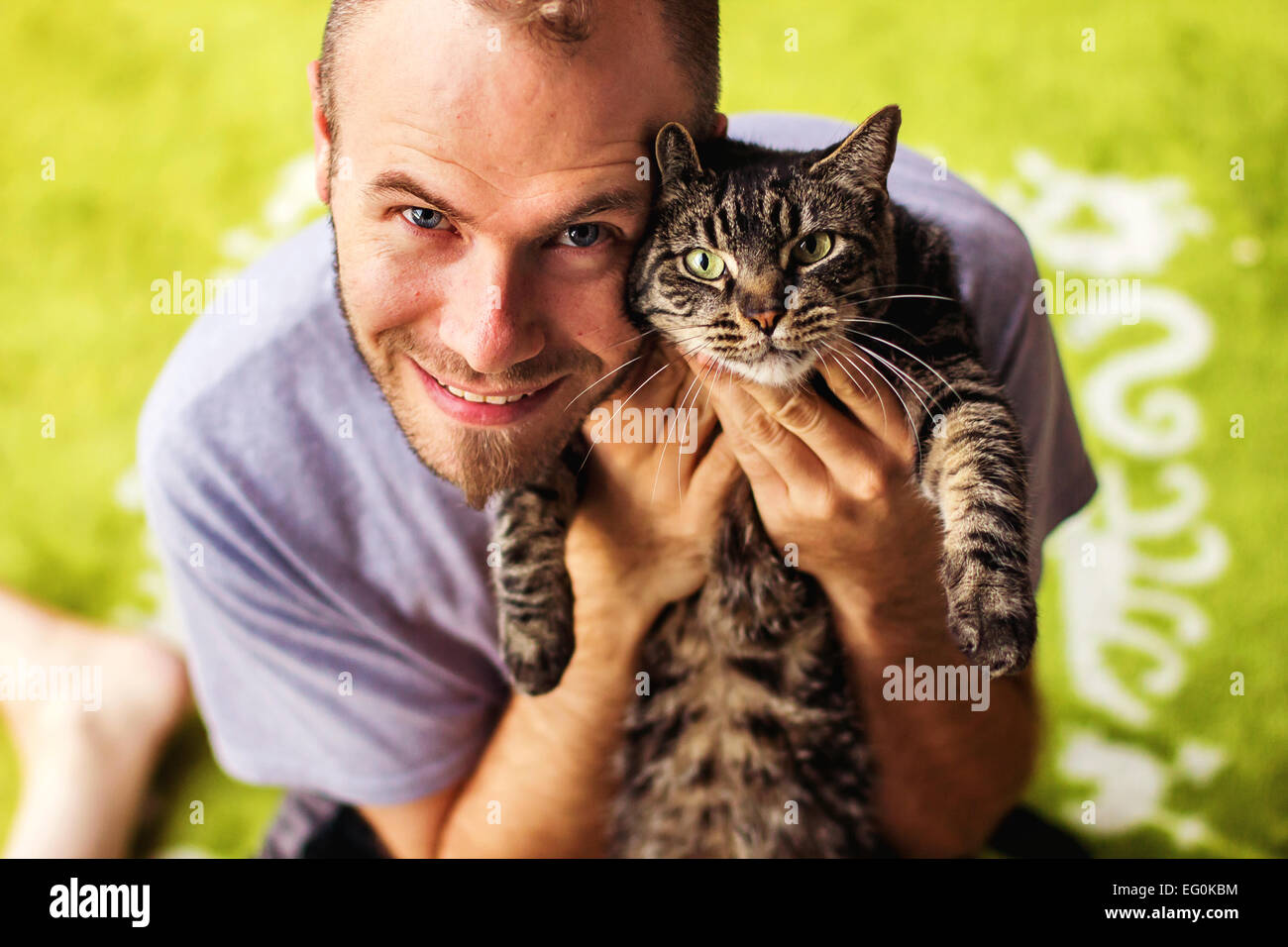 Portrait of man with tabby cat Stock Photo