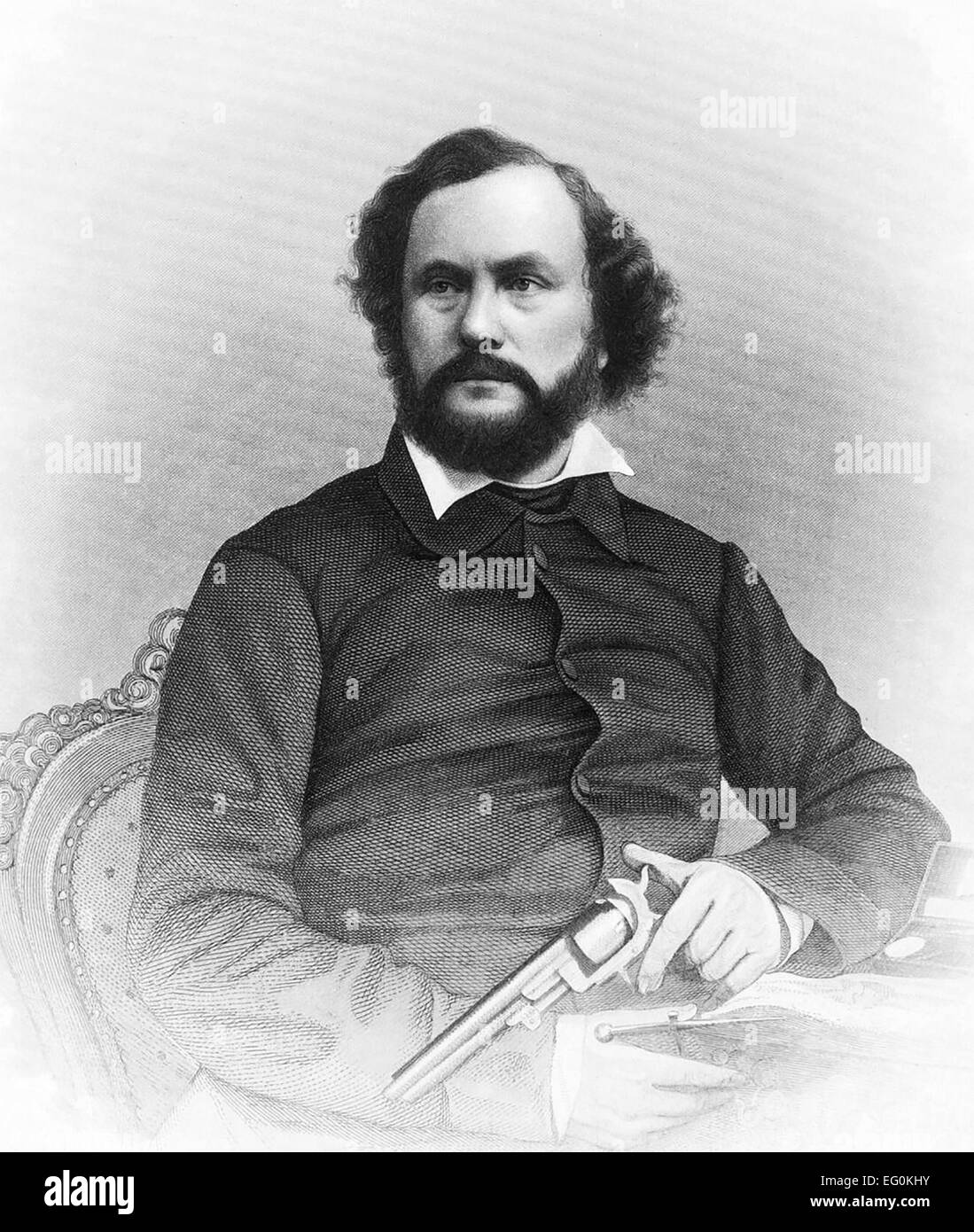 SAMUEL COLT (1814-1862) American inventor of the first mass production revolver seen here with an 1851 Naval Revolver - Stock Image