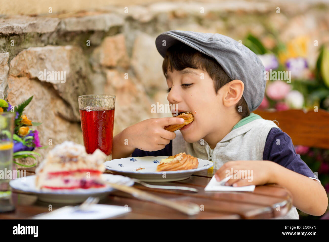 Bulgaria, Sofia, Boy (4-5) eating croissant Stock Photo