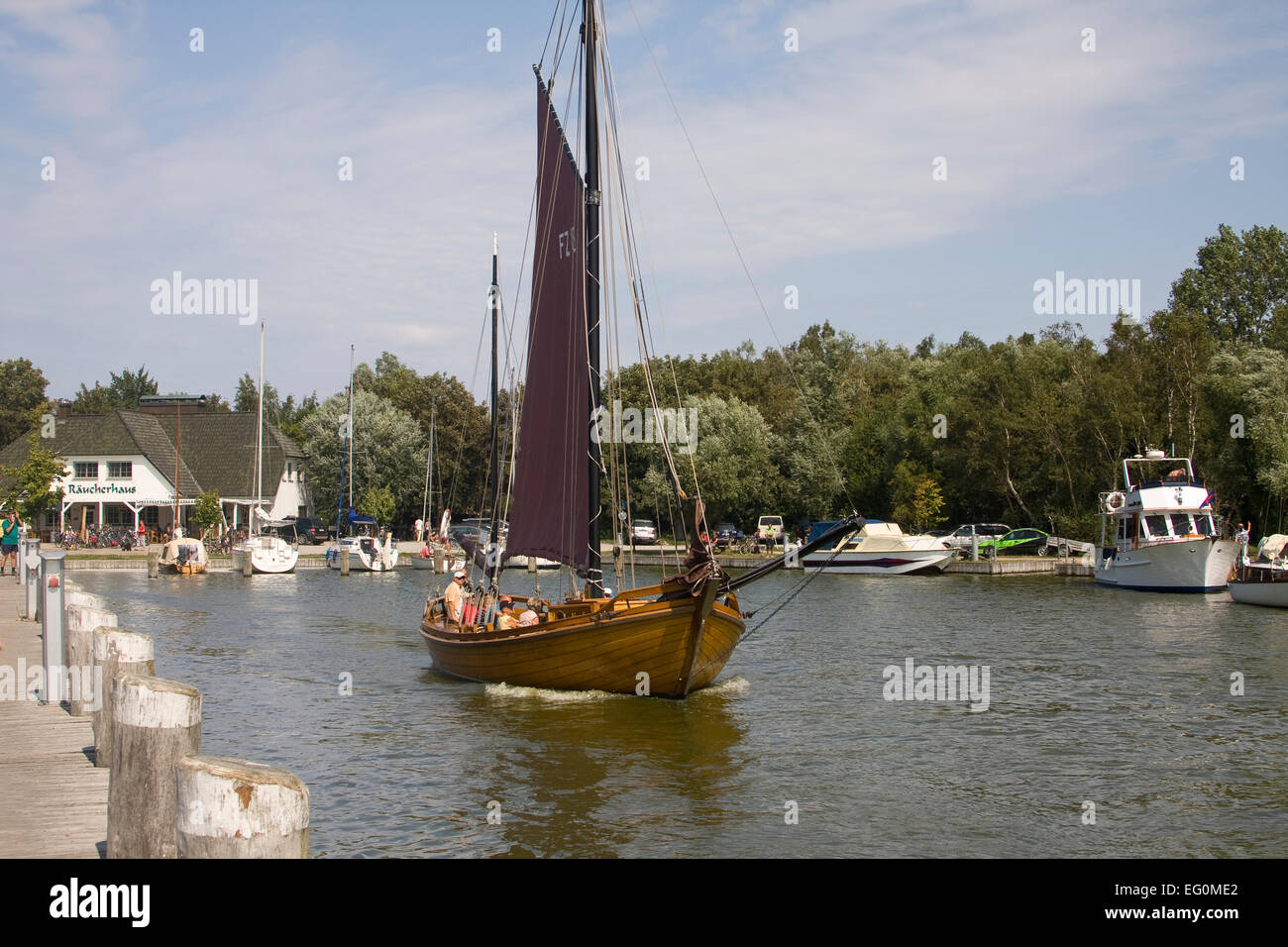 A traditional Zeesboat in the port of Althagen to Ahrenshoop on the Darß, Mecklenburg-Vorpommern - Stock Image