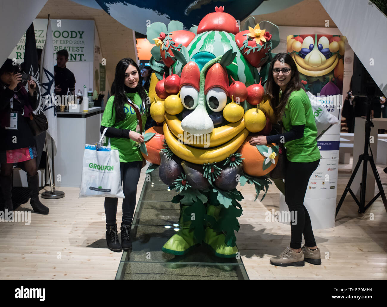 MILAN, ITALY: visitors pose with the Expo 2015 mascotte, Foody, at the Expo2015 stand during BIT at Rho-Fiera in - Stock Image