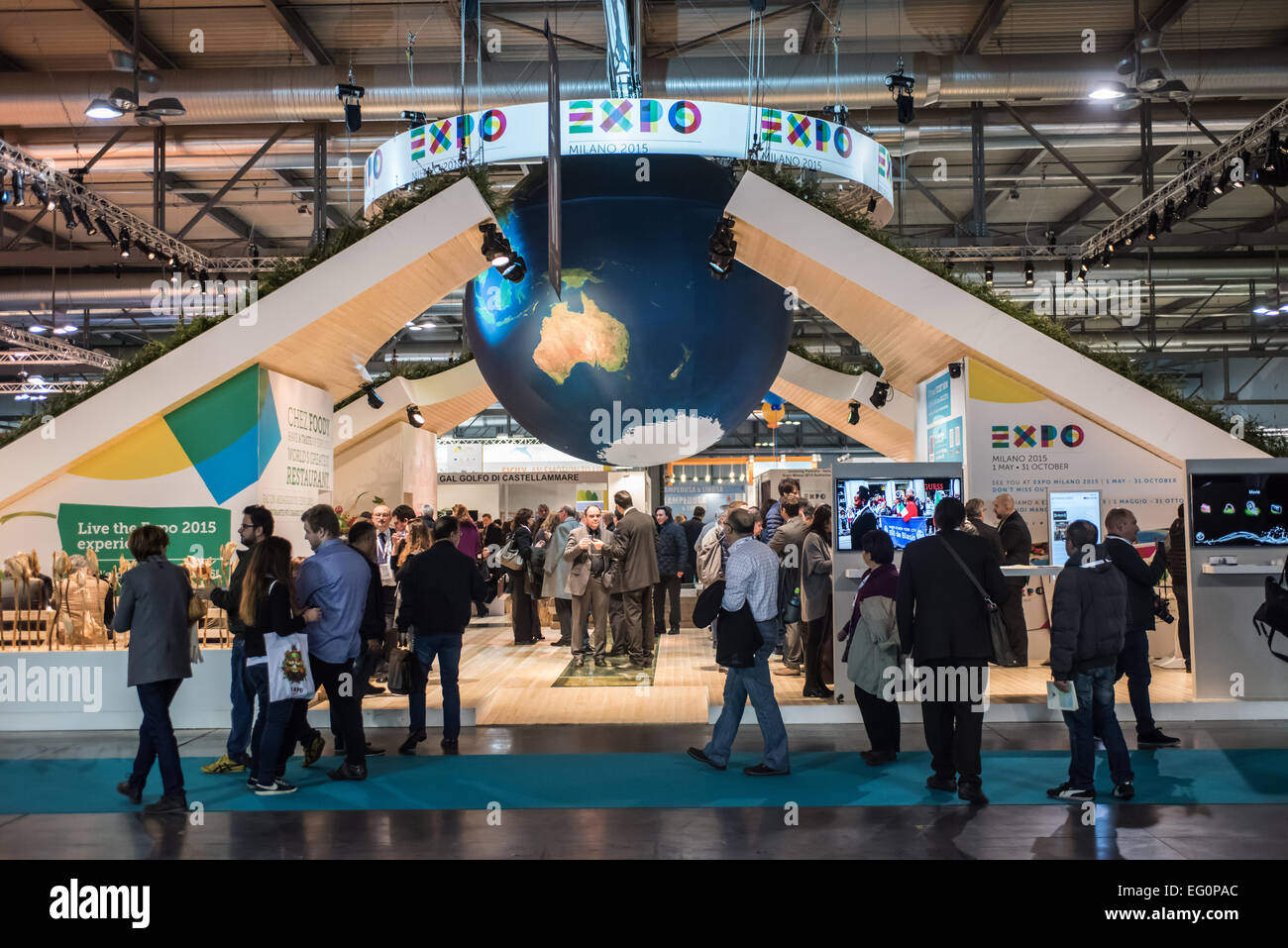 MILAN, ITALY: visitors walk in front of the Expo 2015 stand during BIT at Rho-Fiera in Milan on February 12, 2015 - Stock Image