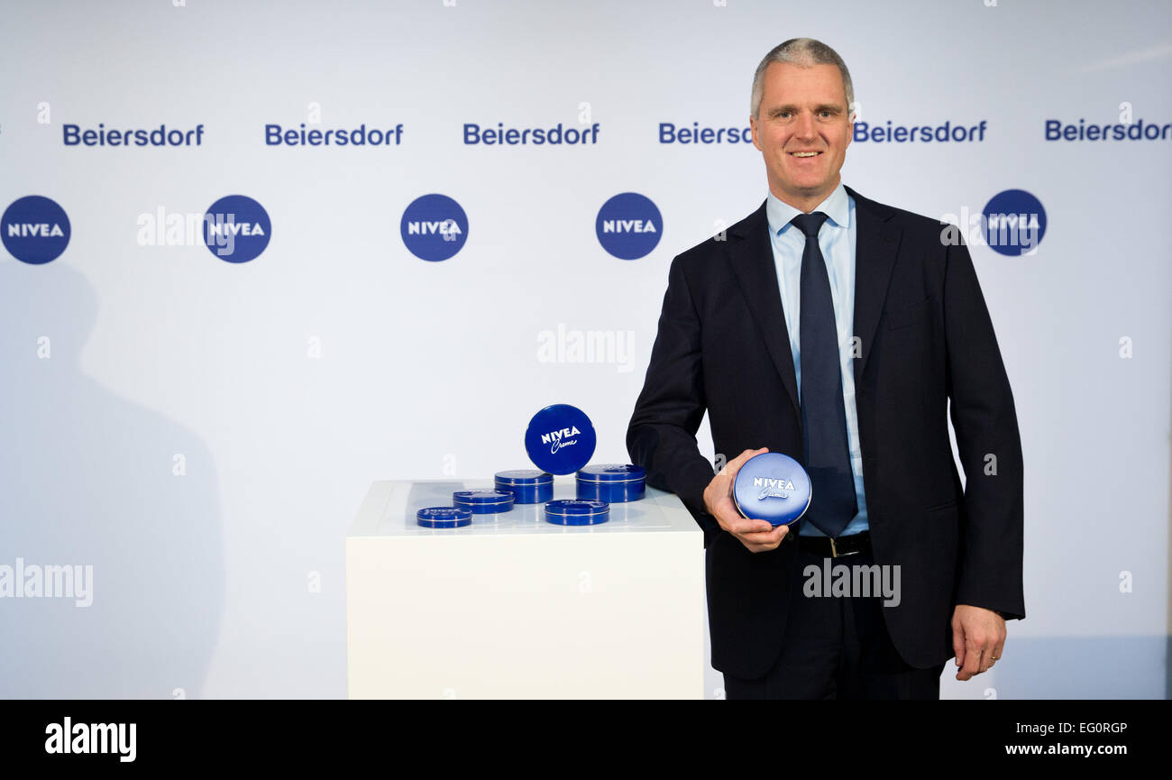 Hamburg, Germany. 13th Feb, 2015. Chairman of Beiersdorf AG, Stefan Heidenreich, holding a tin of Nivea creme before - Stock Image