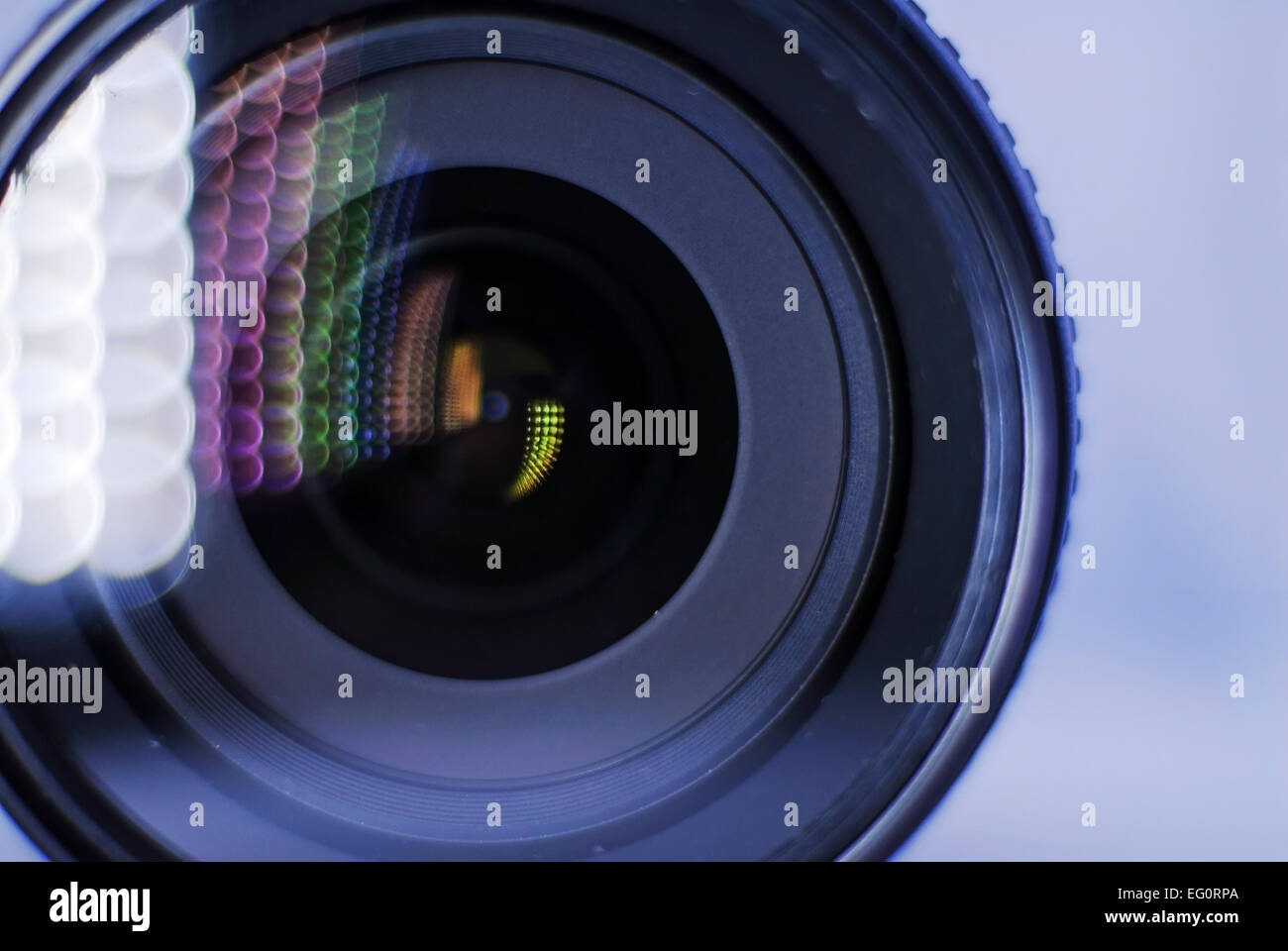 Nikon camera lens taken close up, using a torch to create the colours running back into the lens. - Stock Image