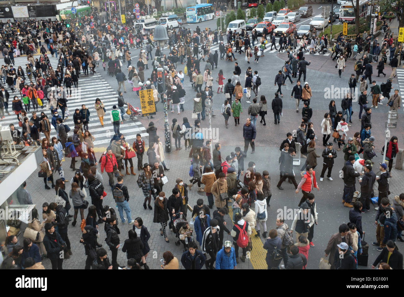 Crowds at the Sibuya crossing in front of Shibuya station. The crossing is reputed to be one of the world's - Stock Image