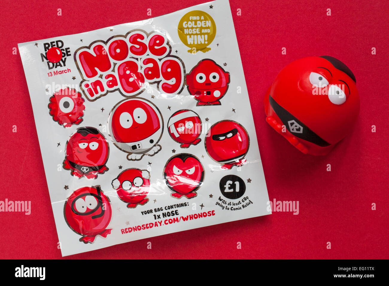 Nose in a Bag find a golden nose and win ready for Red Nose Day on 13 March  with Supernose red nose on red background Stock Photo