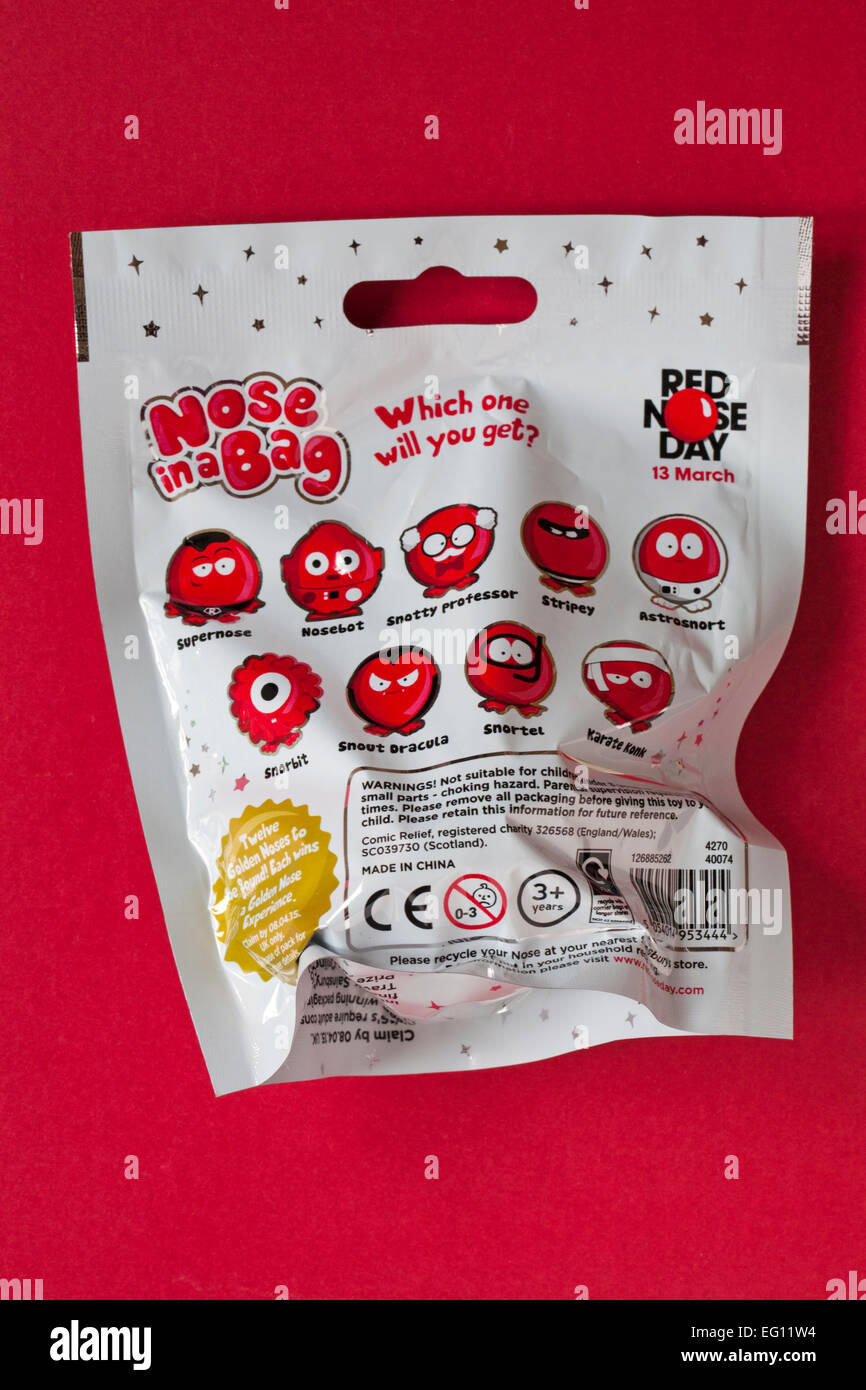 Nose in a Bag which one will you get ready for Red Nose Day on 13 March isolated on red background Stock Photo