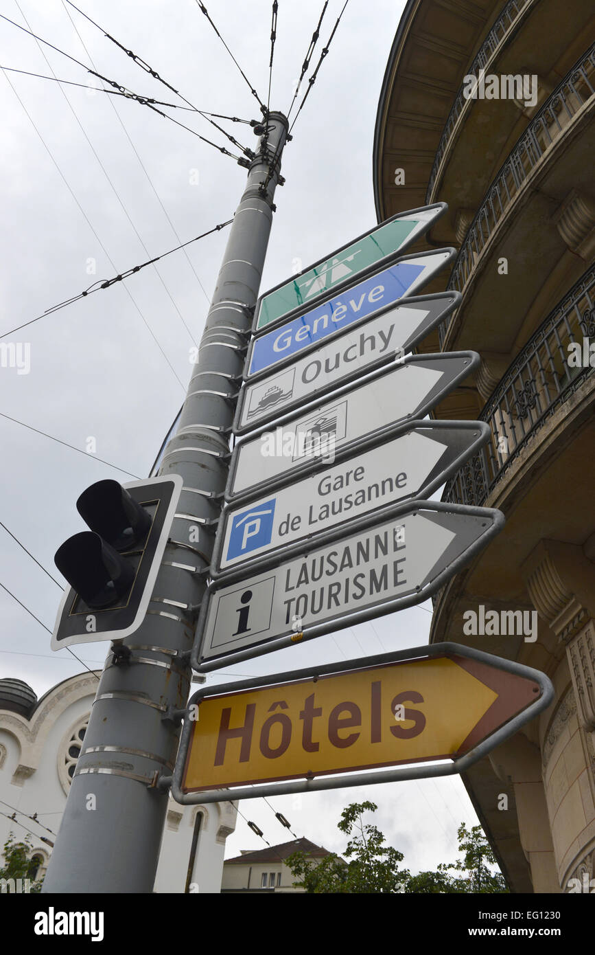 Direction Signs attached to Trolleybus Pole in Lausanne, Switzerland - Stock Image