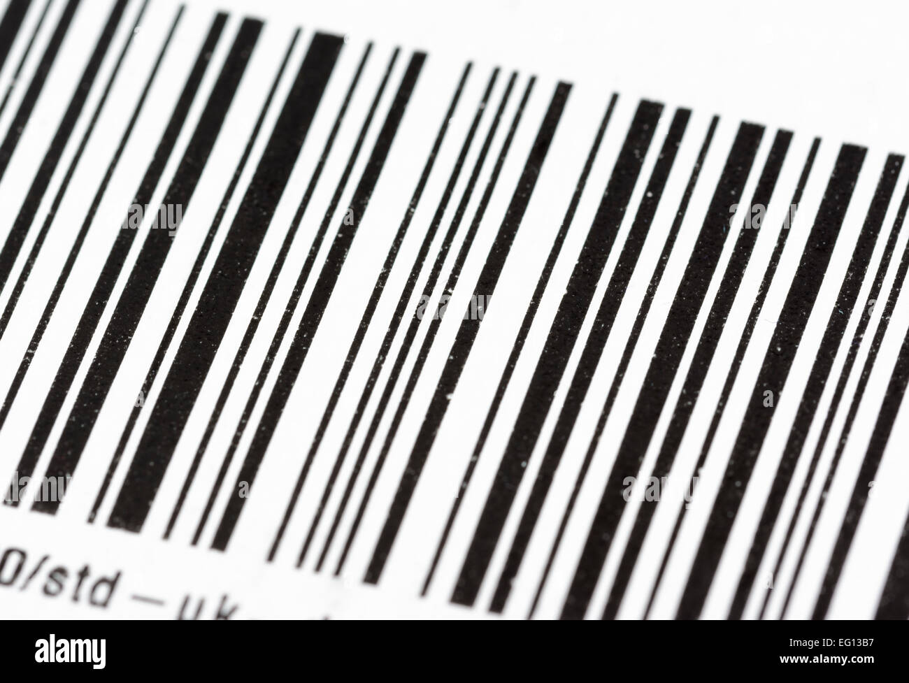 Barcode label on paper at a slight angle. - Stock Image