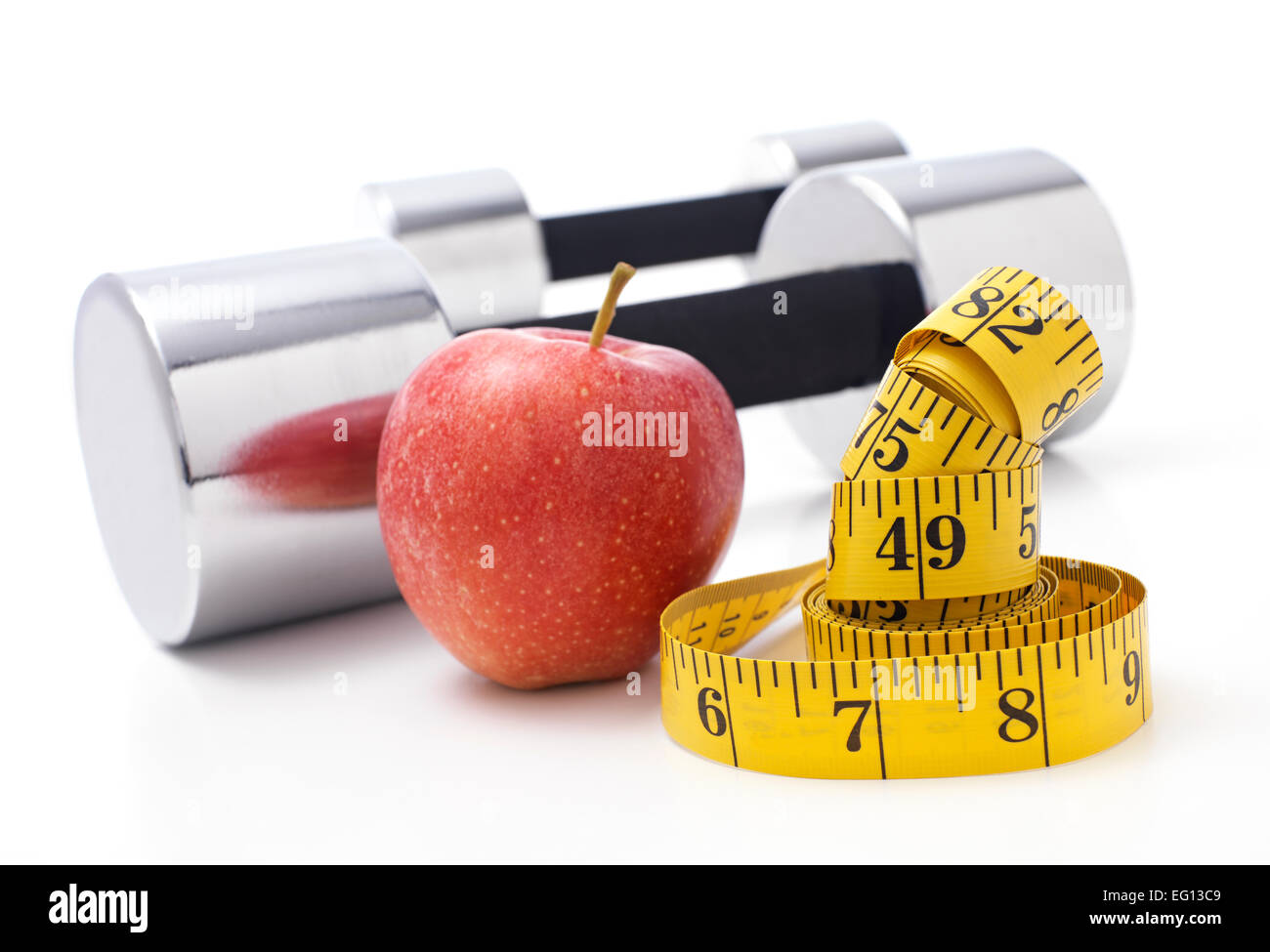 Gym Dumbbells with an Apple - Stock Image