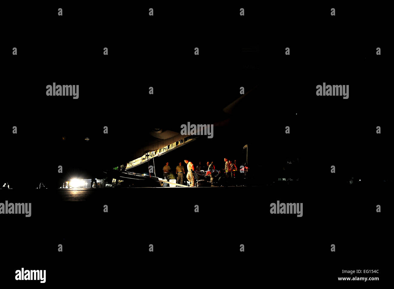 Haitian earthquake patients are transported onto a C-130 from the 908th Air Lift Wing, Maxwell AFB, AL, by Aero - Stock Image