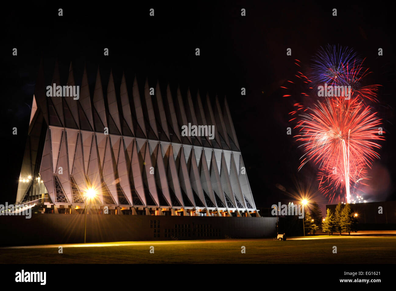 Fireworks explode beyond the Cadet Chapel as thousands braved severe weather to view the patriotic display at the Stock Photo