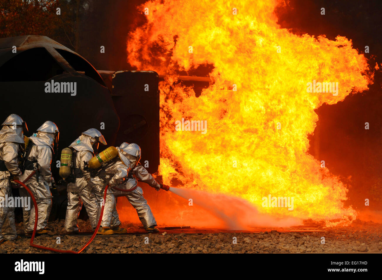 Firefighters from the Ohio Air National Guard's 180th Fighter Wing extinguish an aircraft fire during a training Stock Photo