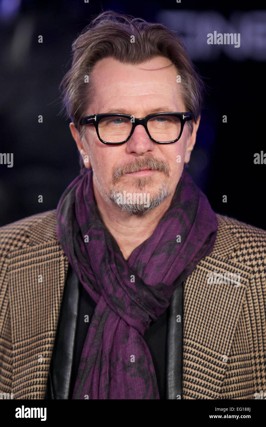 UNITED KINGDOM: British actor Gary Oldman poses for pictures on the red carpet as he arrives for the world premier - Stock Image