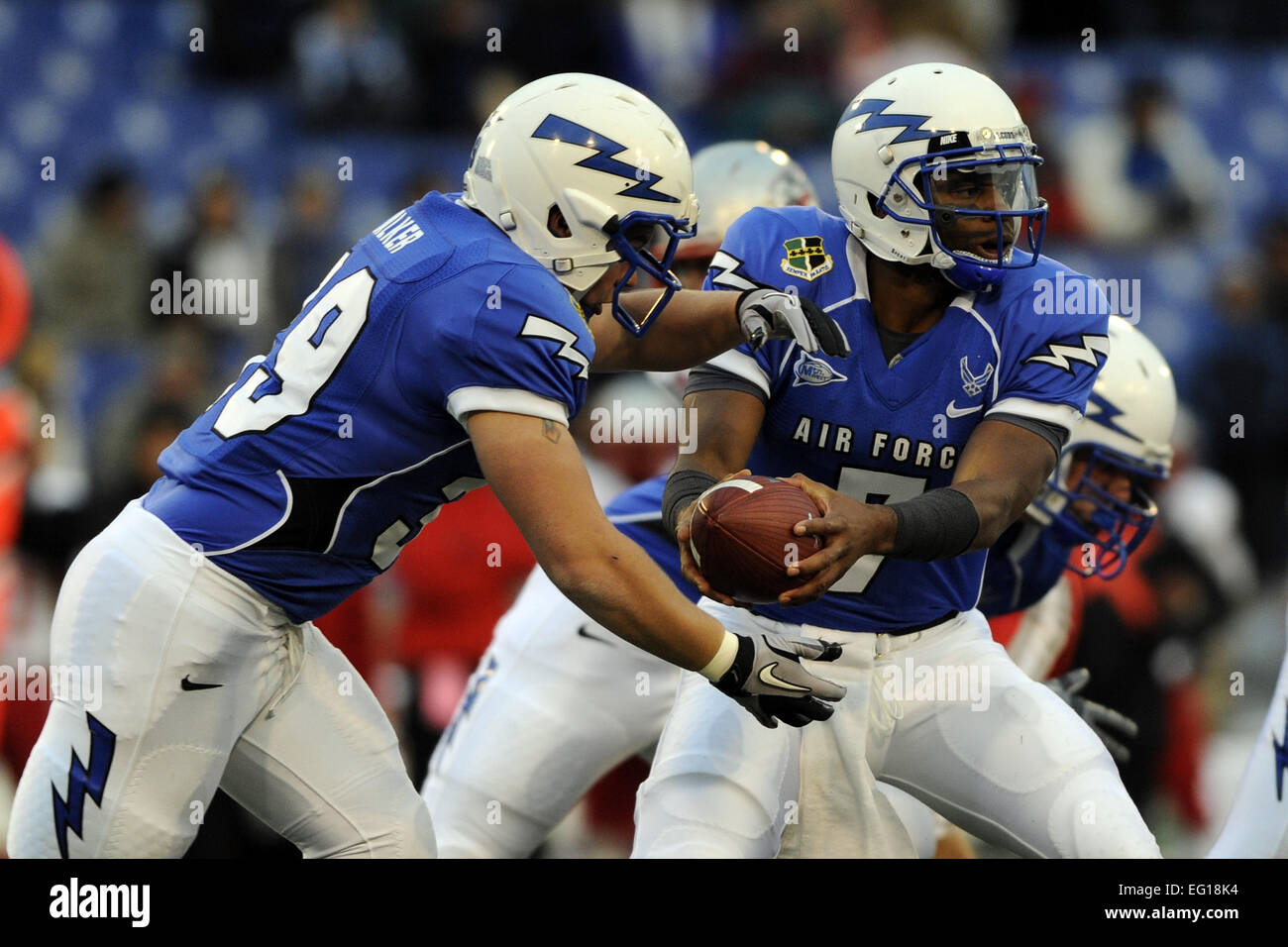 U.S. Air Force Academy Senior running back Nathan Walker takes the handoff from quarterback Tim Jefferson during - Stock Image