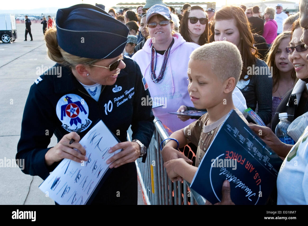U.S. Air Force Capt. Petrina Hanson, the Thunderbirds executive officer, signs an autograph for a young fan Nov. - Stock Image