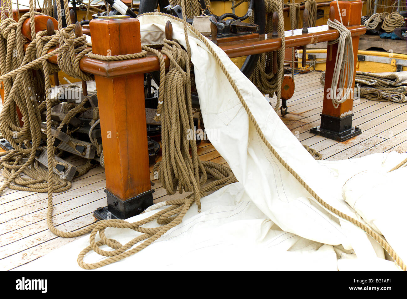 Deck of old sailing ship with ropes and sail cloth - Stock Image