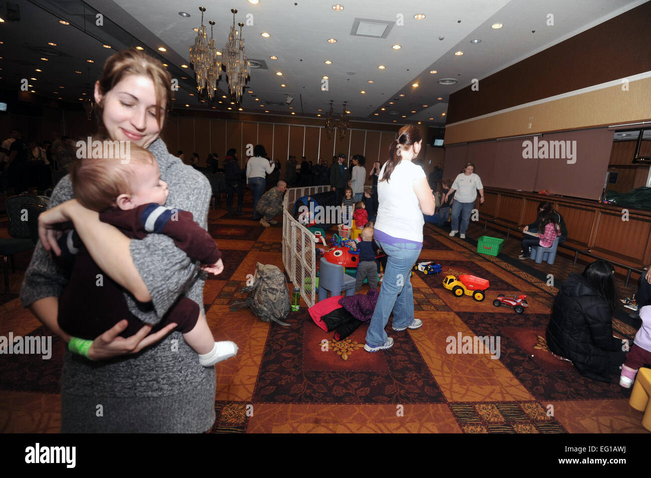 Through all the commotion going on in the Enlisted club ballroom due to the voluntary evacuation of Misawa Air Base - Stock Image