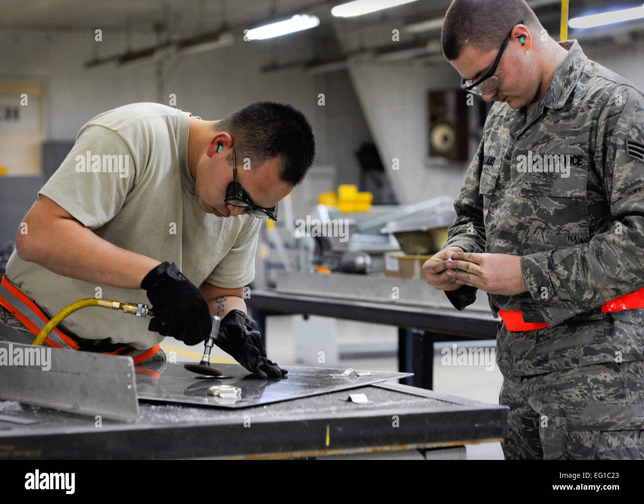 YOKOTA AIR BASE, Japan -- Senior Airman Thompson Kongmany and Senior Airman Mark Williams, 374th Maintenance Squadron - Stock Image