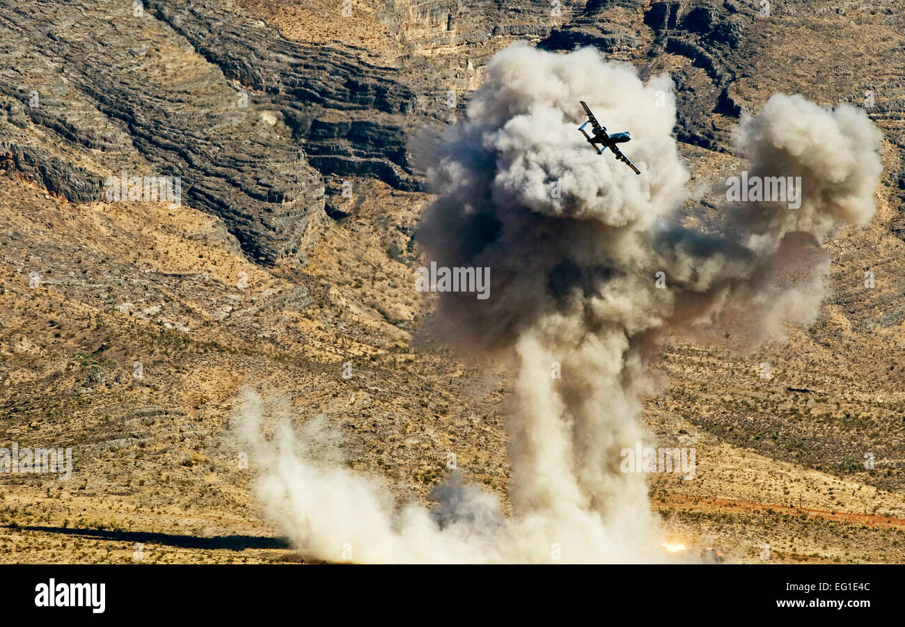 A U.S. Air Force A-10 Thunderbolt II ground attack aircraft with the U.S. Air Force Weapons School drops an AGM - Stock Image