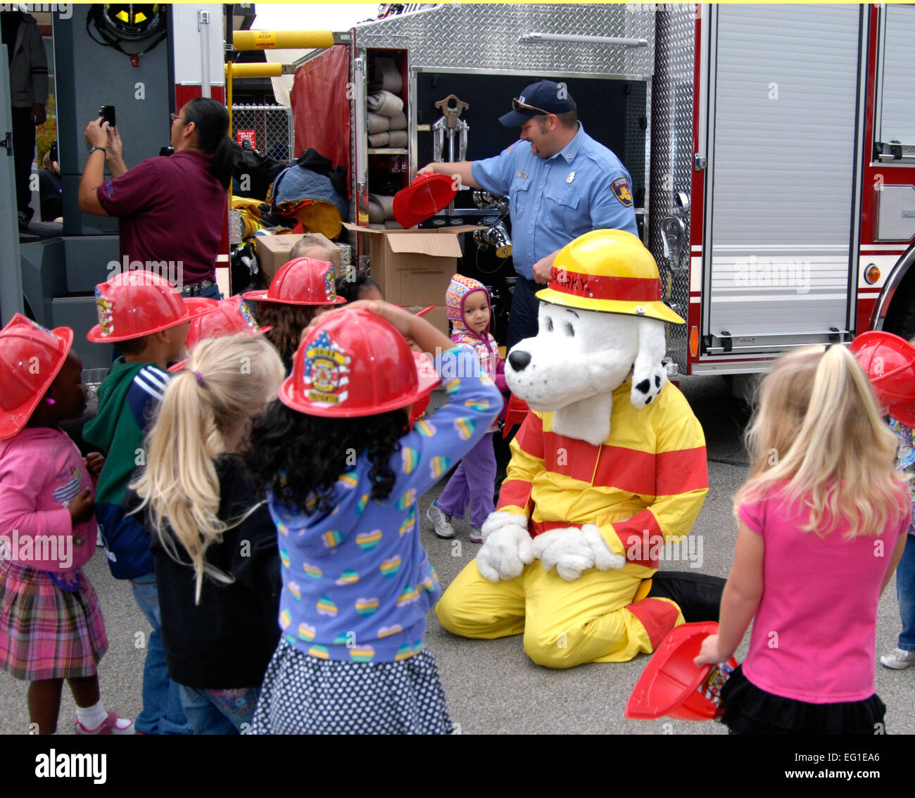 Sparky The Fire Dog Plays With Children During A Prevention Awareness Event At Child