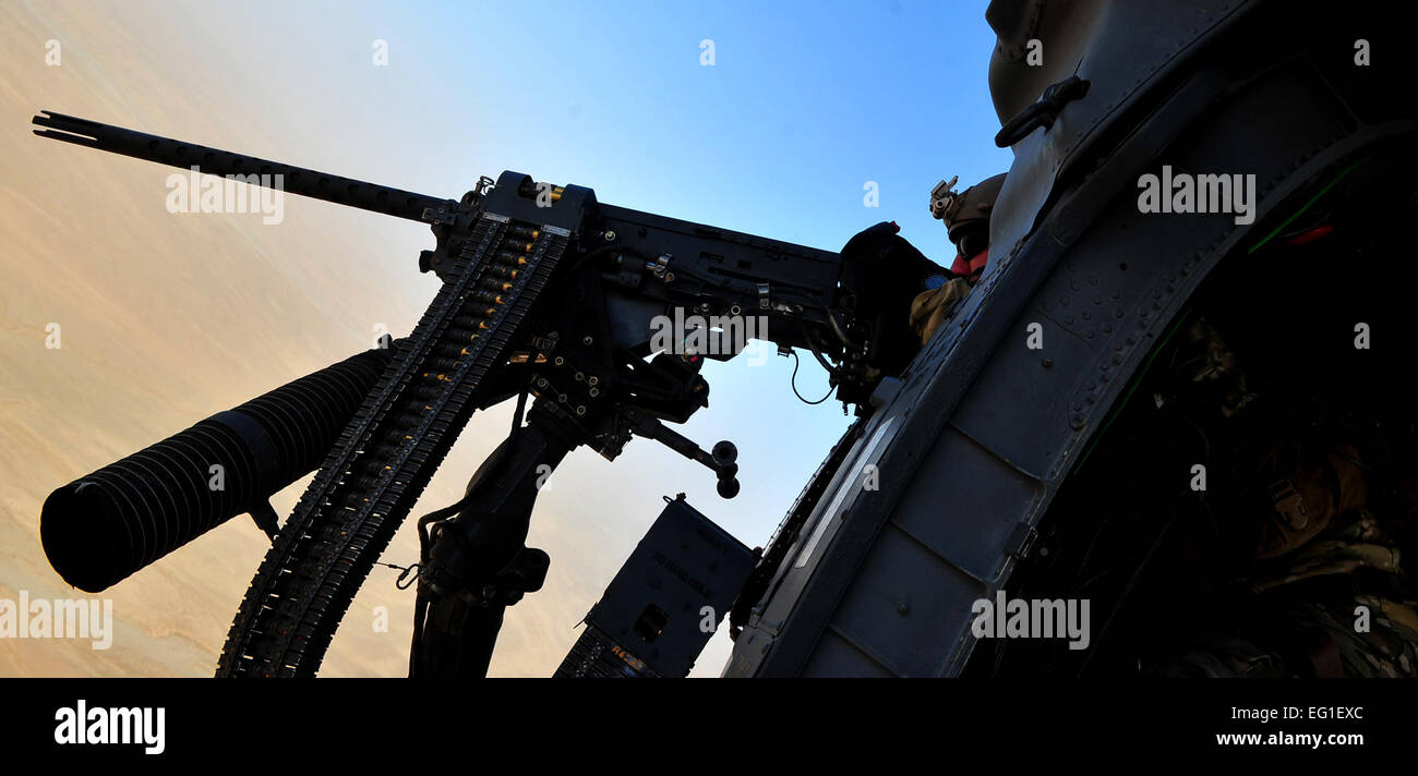 An aircrew member from the 26th Expeditionary Rescue Squadron ERQS mans the .50-caliber machine gun mounted to a - Stock Image