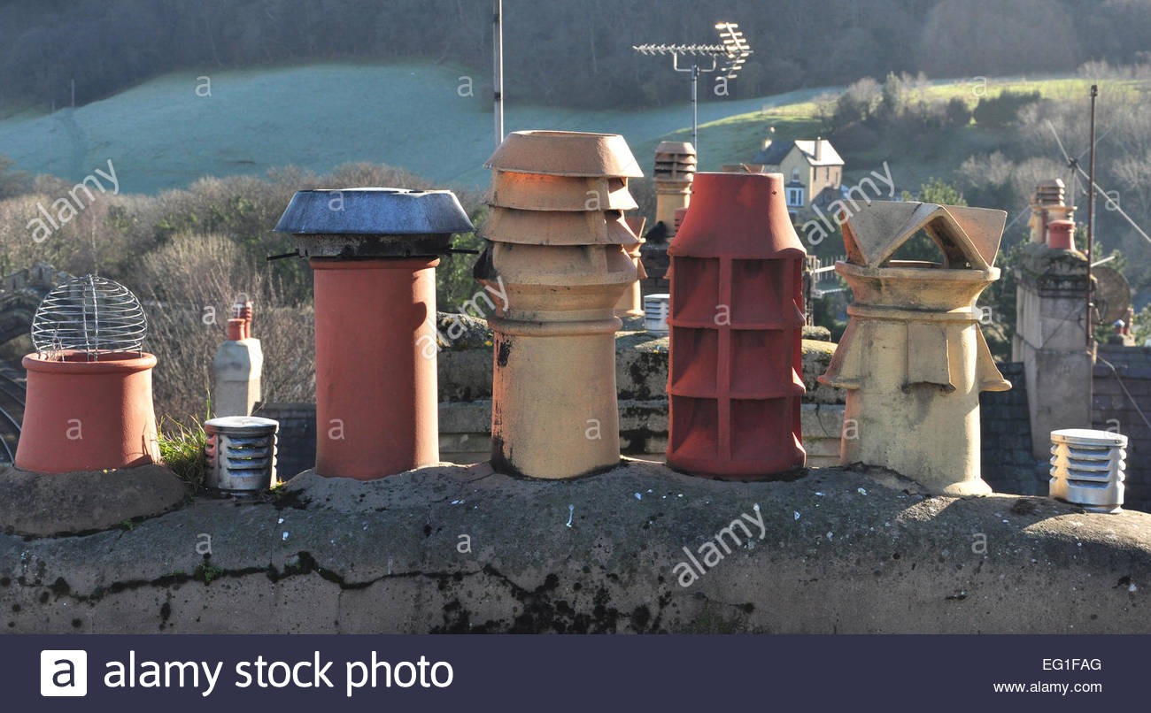 A variety of chimney pots on a roof in the North Wales town of Conwy. - Stock Image