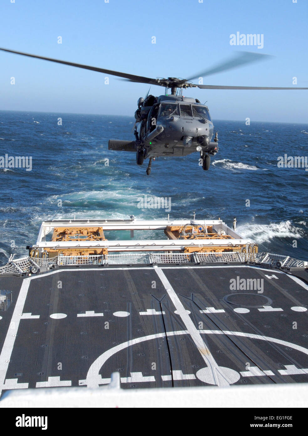 California Air National Guard members assigned to the 129th Rescue Squadron conduct aircraft deck landing qualifications Stock Photo