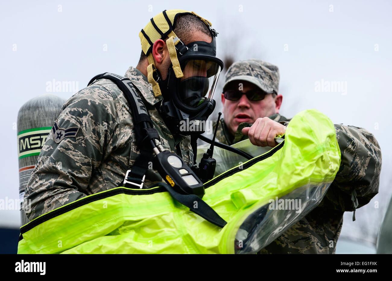 U.S. Air Force Master Sgt. Robert Stewart, 192nd Mission Support Group emergency management technician, assists - Stock Image