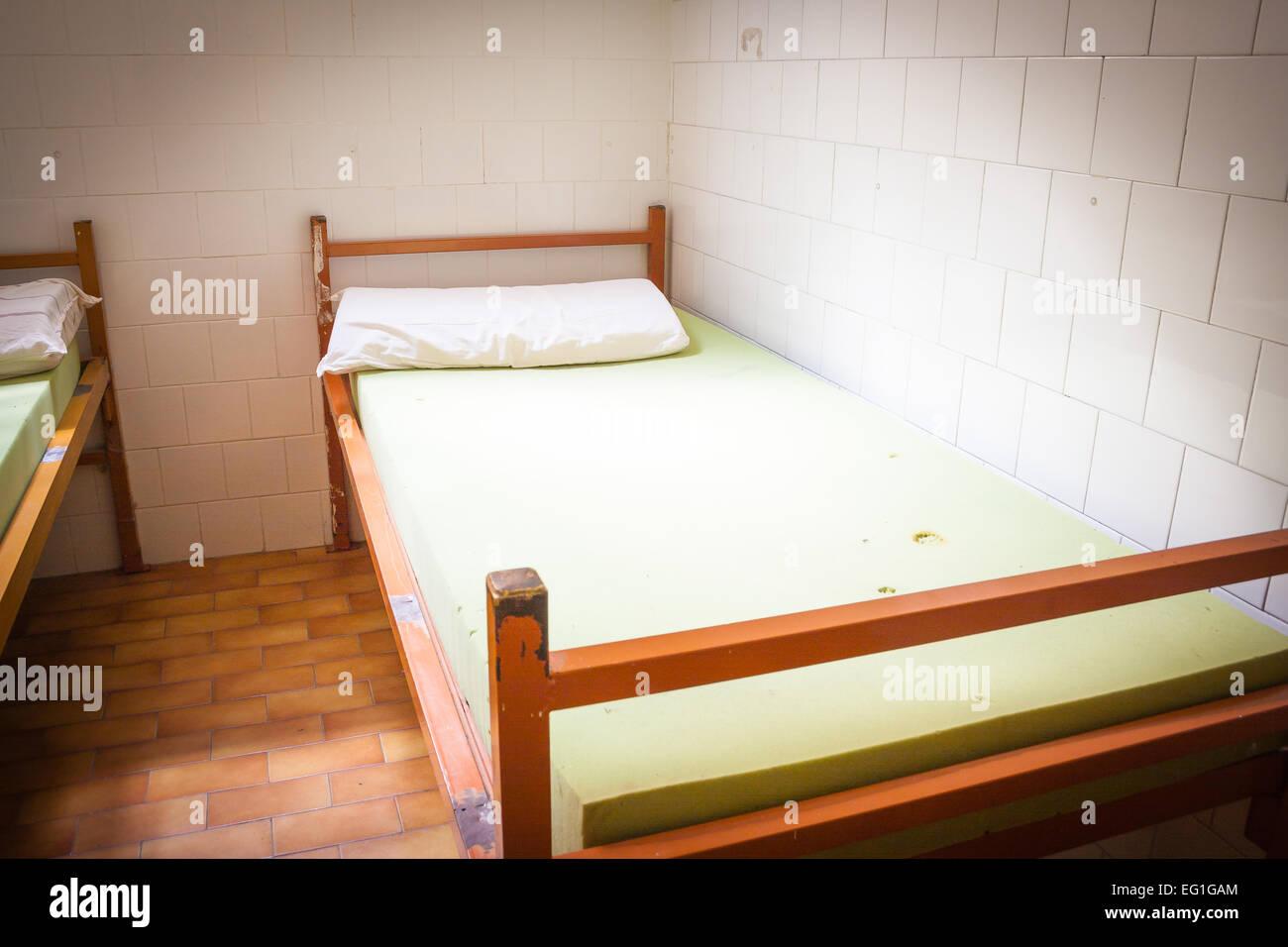 Old psychiatric hospital. Old bed in psychiatric ward Stock Photo