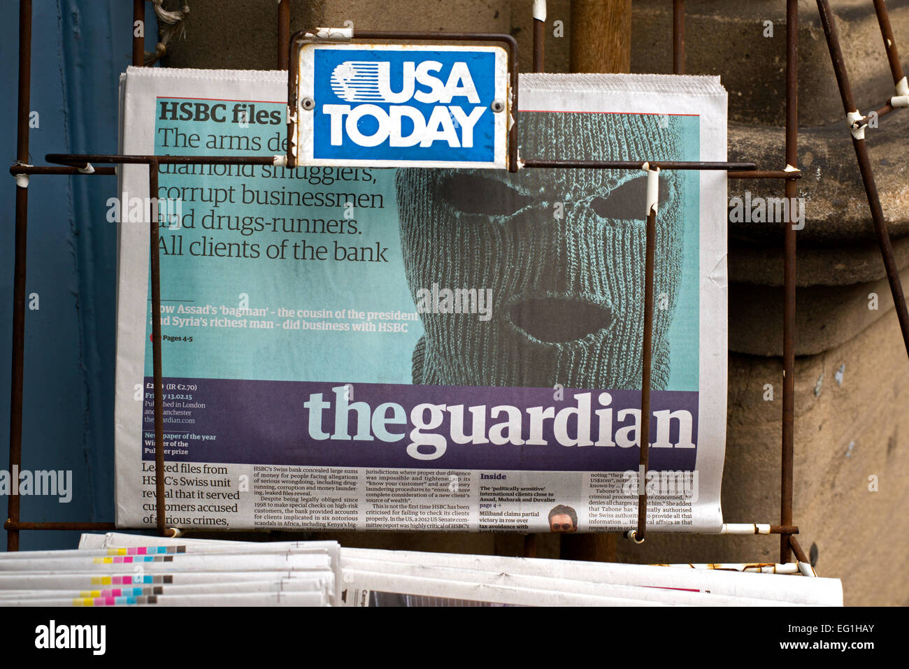 Newsstand with a copy of The Guardian with photo of mask and HSBC headline. - Stock Image