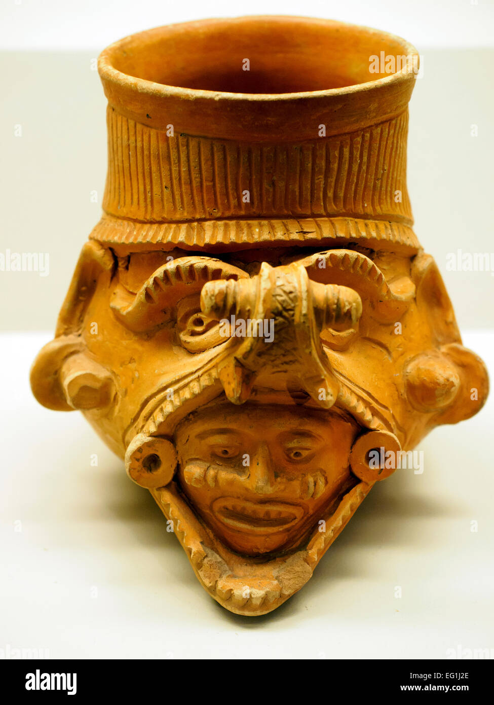 Pottery vessel with head emerging from serpent jaws Isla de Sacrificios, AD 900-1521 - Stock Image