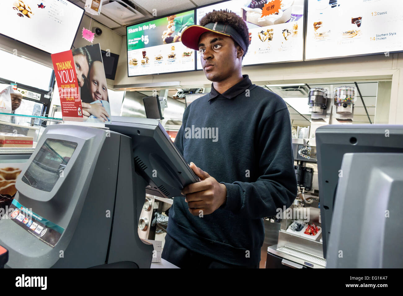 Florida Sebastian McDonald's restaurant fast food inside counter Black man cashier employee job working possible - Stock Image