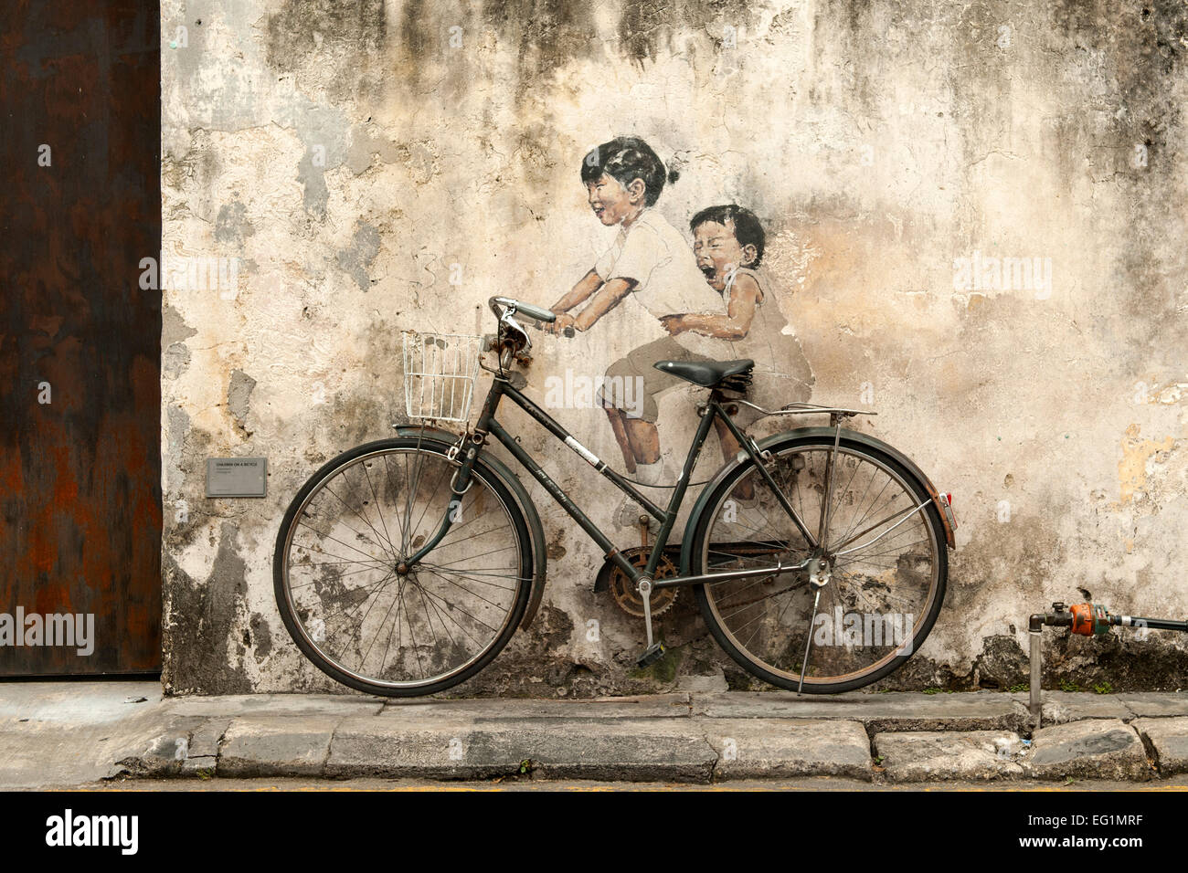 'Children on a bicycle' by Ernest Zacharevic. It is part of the street art in George Town, the capital of - Stock Image
