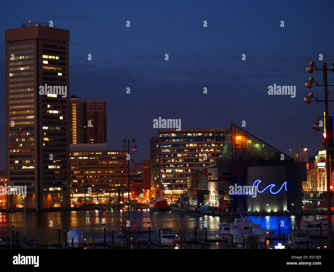 BALTIMORE, MD - February 11, 2015:  The World Trade Center, the National Aquarium, and other buildings light up Stock Photo