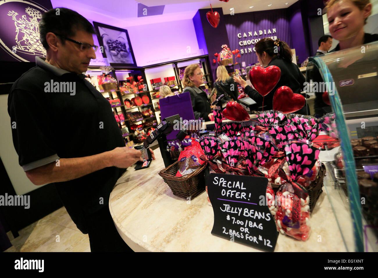 Vancouver, Canada. 13th Feb, 2015. Cutsomers choose chocolates at a candy store in Vancouver, Canada, Feb. 13, 2015. - Stock Image