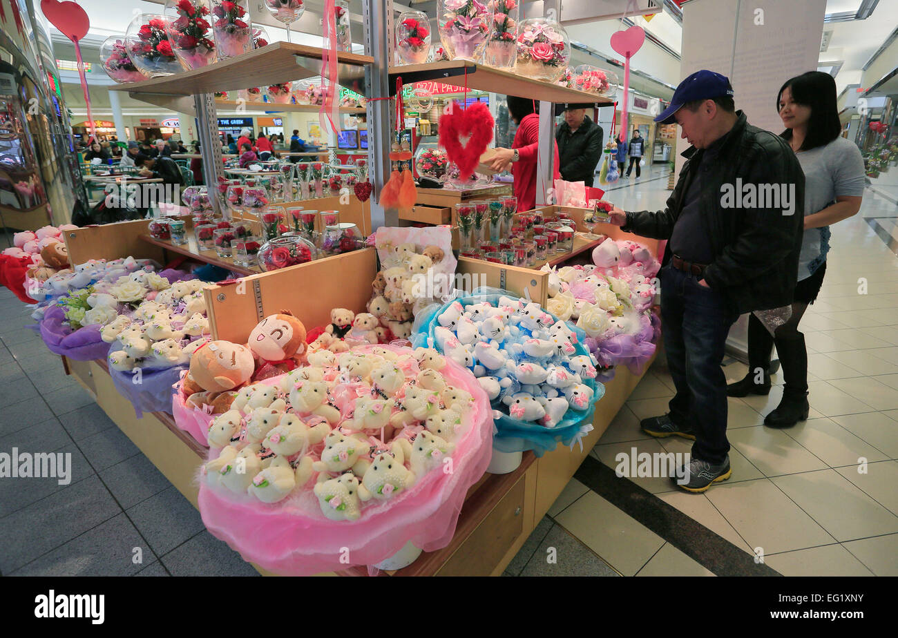 Vancouver, Canada. 13th Feb, 2015. People choose flower decorations at a shopping mall in Vancouver, Canada, Feb. - Stock Image