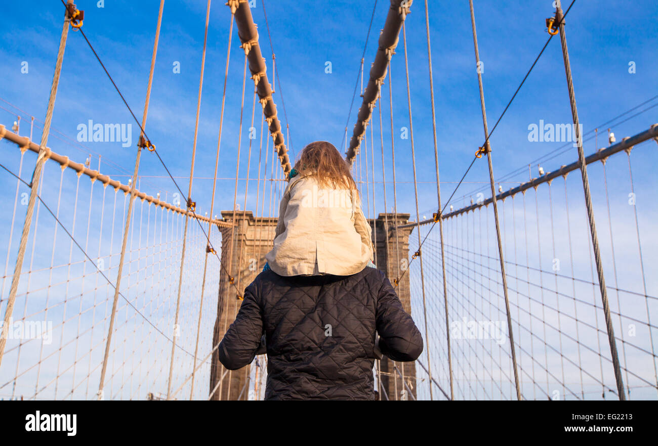 Dad and little girl on Brooklyn bridge, New York City, USA - Stock Image