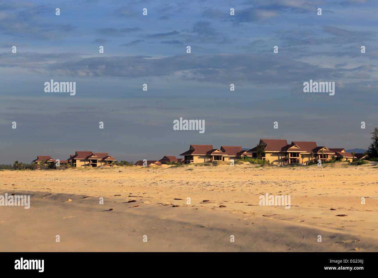 Houses on South China Sea beach near Tam Ky, Vietnam - Stock Image
