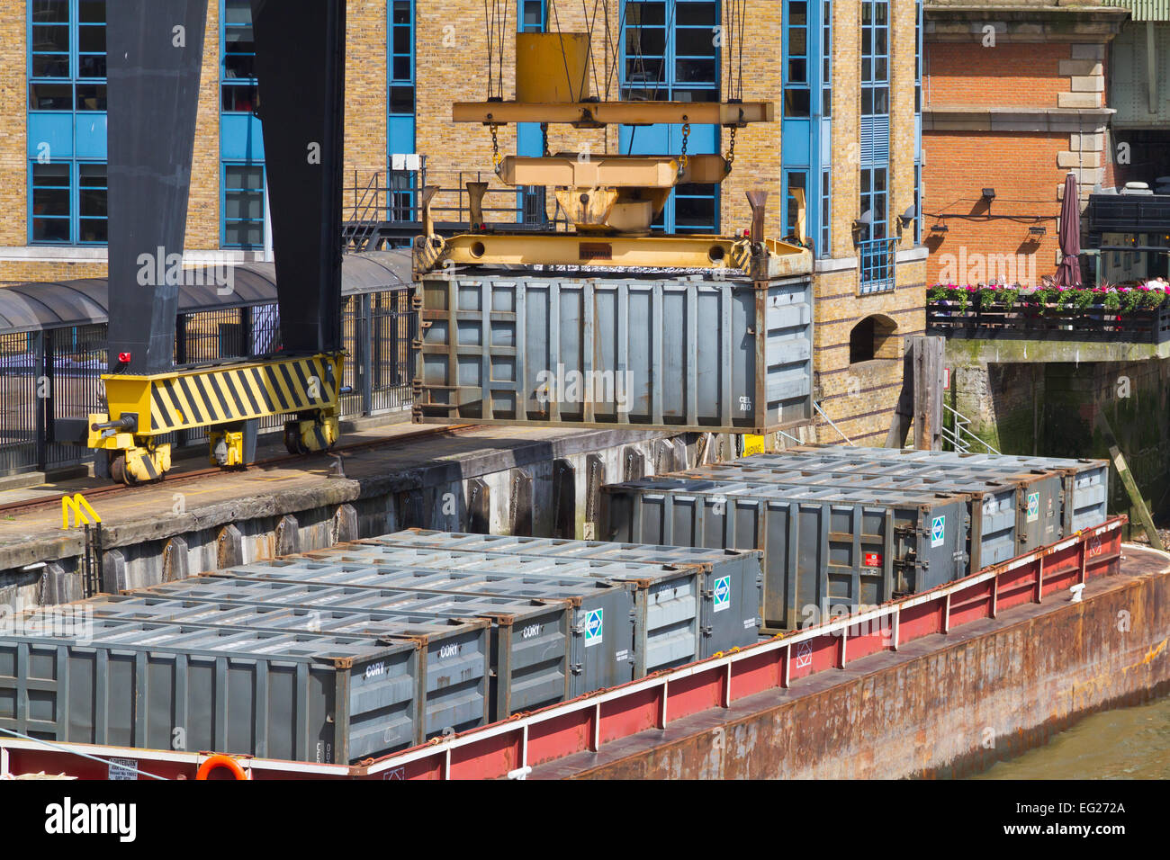 Walbrook Wharf waste containers being loaded onto a barge, City of London - Stock Image