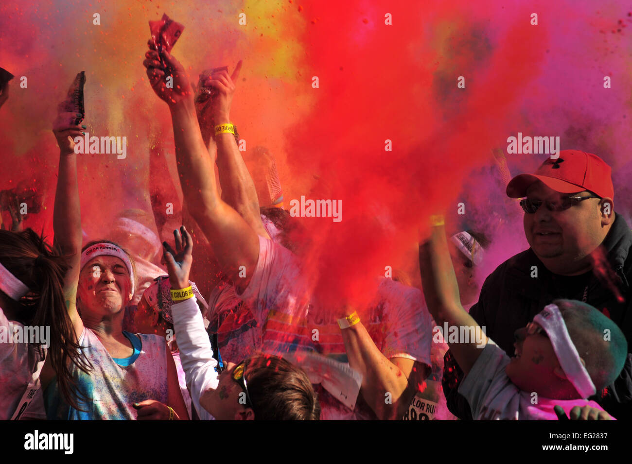Colored powder is thrown into the air after participants complete The Color Run™ 5K March 23, 2013, in Lubbock, - Stock Image