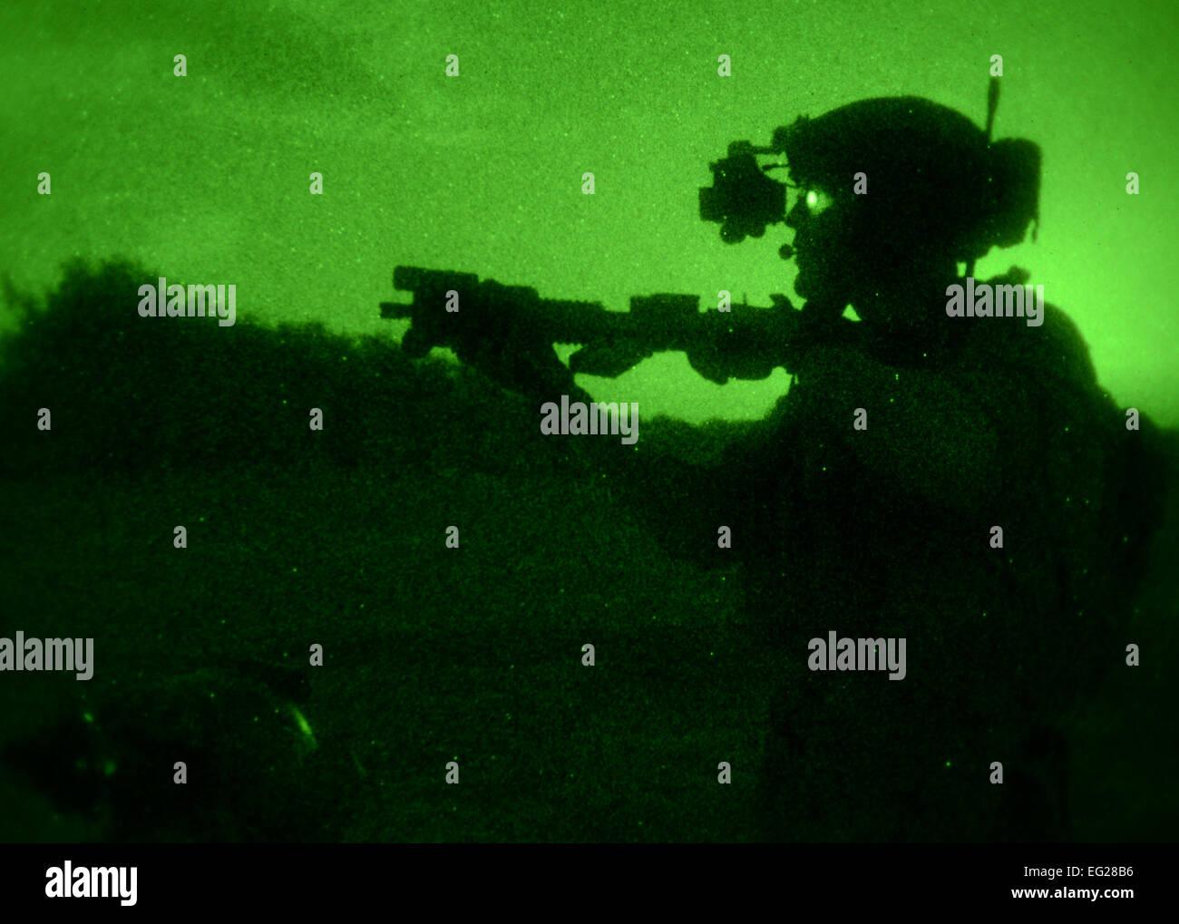 A U S  Air Force Air Commando aims his weapon to designate a