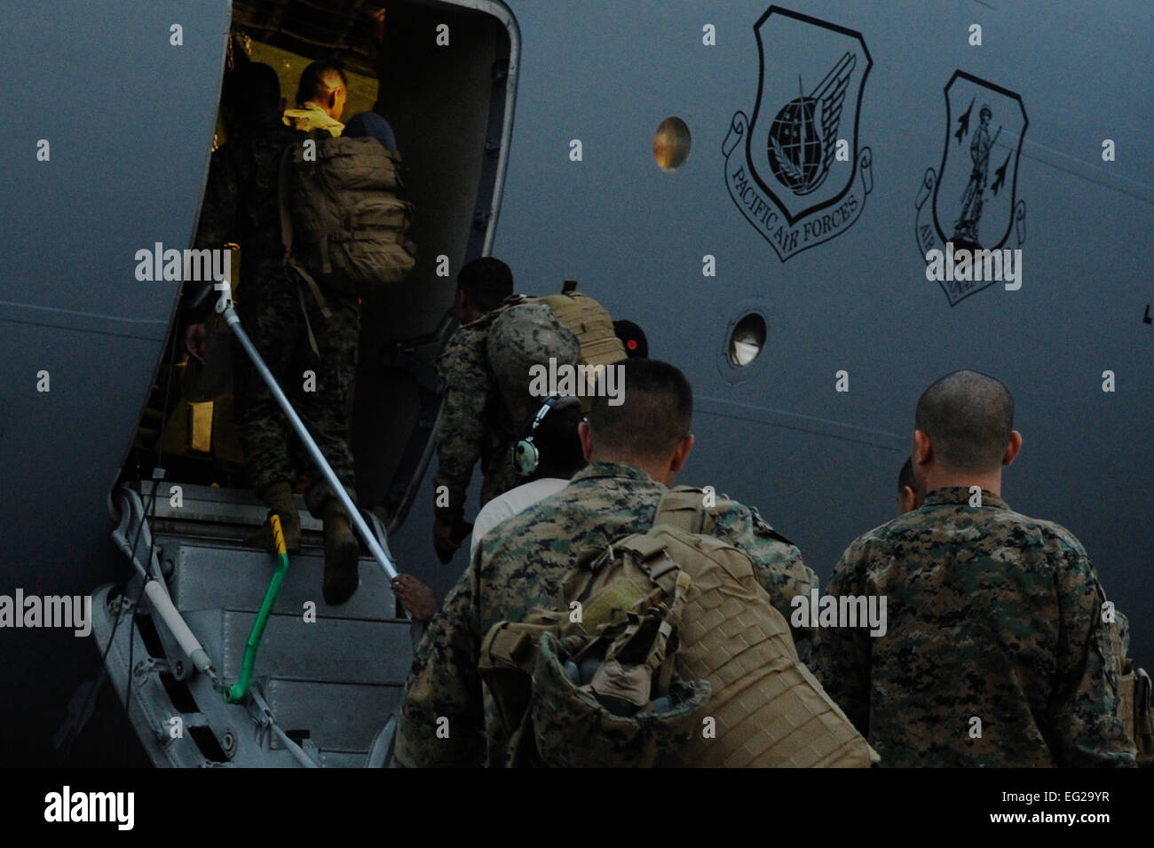 More than 50 Marines from the III Expeditionary Force at Marine Corps Air Station Futenma, Okinawa, Japan, load - Stock Image