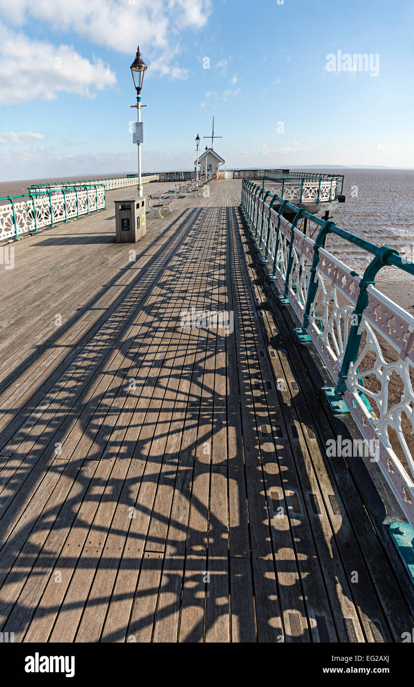Shadows from the renovated Victorian wrought iron railings on the pier at Penarth, Wales, UK - Stock Image